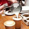 barista pouring milk